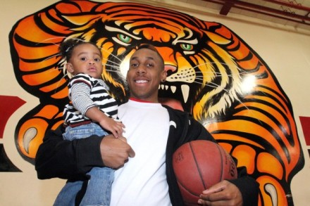 Inland Area Player Of The Year E.J. Twyman, holding his daughter, Makayla. / Photo by Don Boomer for The California.