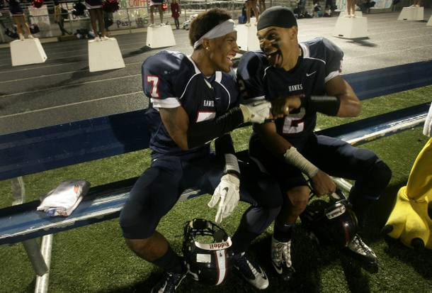 Teammates K.J. Young (left) and Trevor Hodge share a laugh during the CIF-Southern Section Eastern Division championship game victory over Phelan Serrano on Nov. 30, 2012.