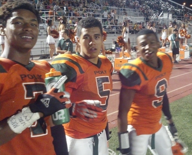 David Samuelu (center) ran for 87 yards and two TDs as Riverside Poly defeated Riverside Ramona, 45-14, on Friday, Sept. 6, 2013.