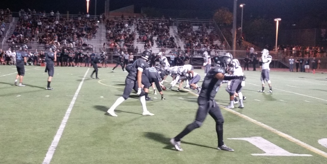 Corona Santiago (dark uniforms) scored 28 points in the third quarter vs. Temecula Chaparral in Week 4.