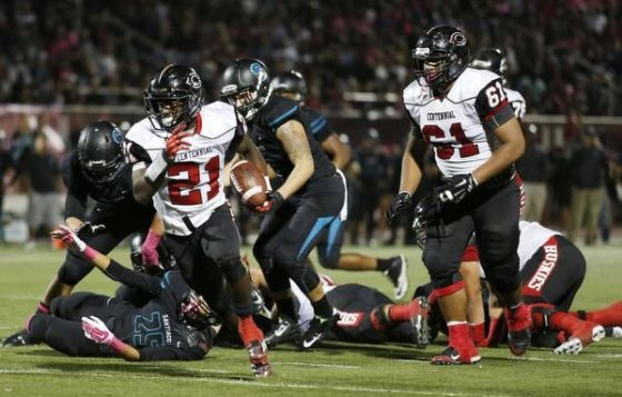 Corona Centennial senior J.J. Taylor ran for 253 yards vs. Santiago in '14 (above) and another 114 this season. / Photo for The Press-Enterprise
