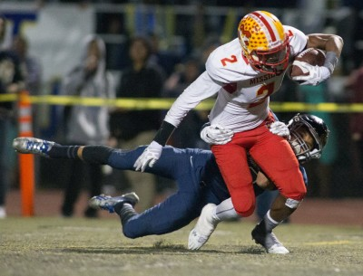 Mission Viejo's Olaijah Griffin breaks away from a Vista Murrieta tackler on Friday, Dec. 4, 2015. / Photo for The Press-Enterprise